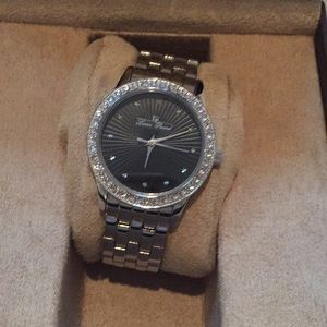 Lucien Piccard silver and black face watch